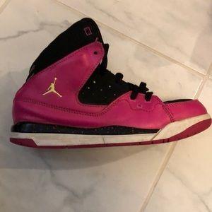 Girls air Jordan high top sneakers.
